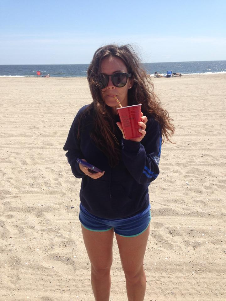 Becky, on Rockaway Beach, drinking a Balanced Bella juice during a 3-day-cleanse.