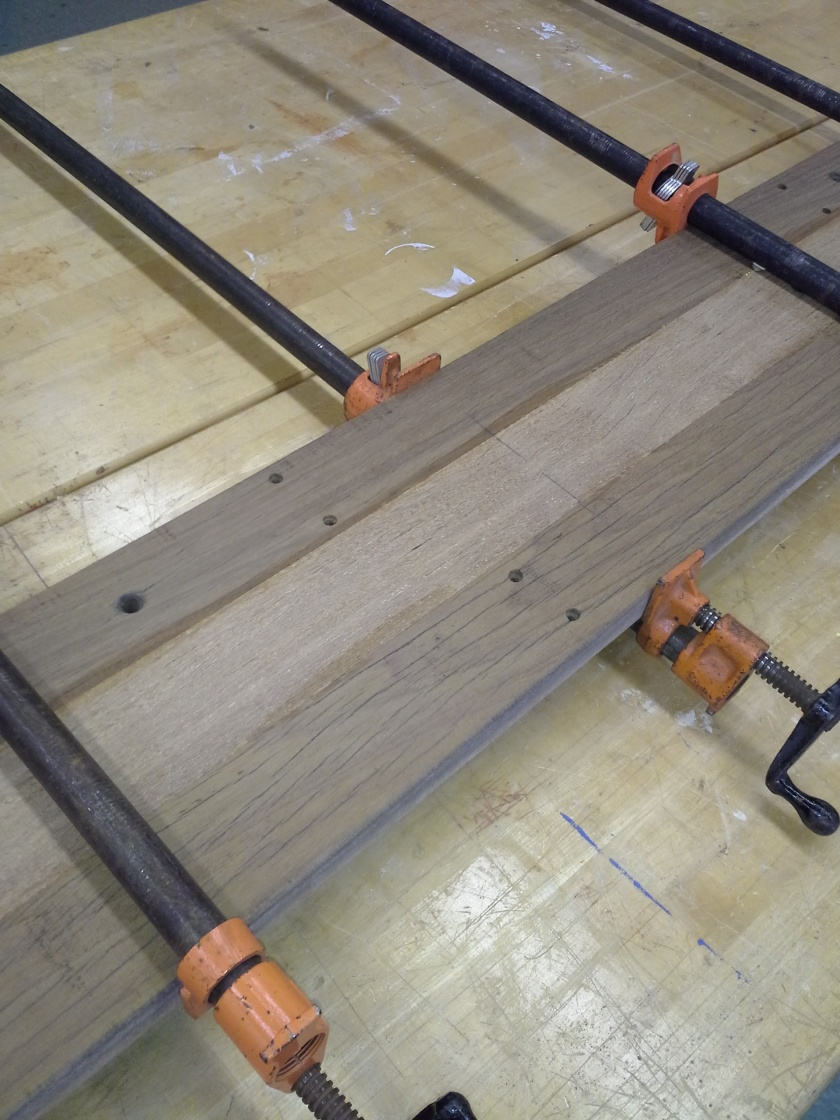 Once dried, wood glue was applied to the planks and held together with clamps.